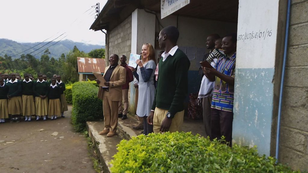 Carina at Isange Secondary College - receiving a Thank You Certificate from the students for donating a printer and laptop