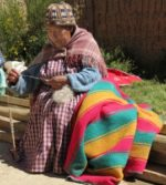 Ayni - woman weaving blanket